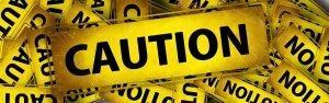 Baner Caution